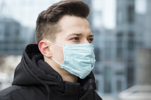 side-view-of-man-wearing-medical-mask-in-the-city_23-2148445018.jpg